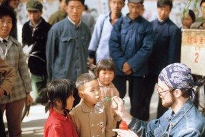 People's diplomacy: John Vivian '81 invites children to blow bubbles as their elders watch. Photograph by Steve Stone '83.