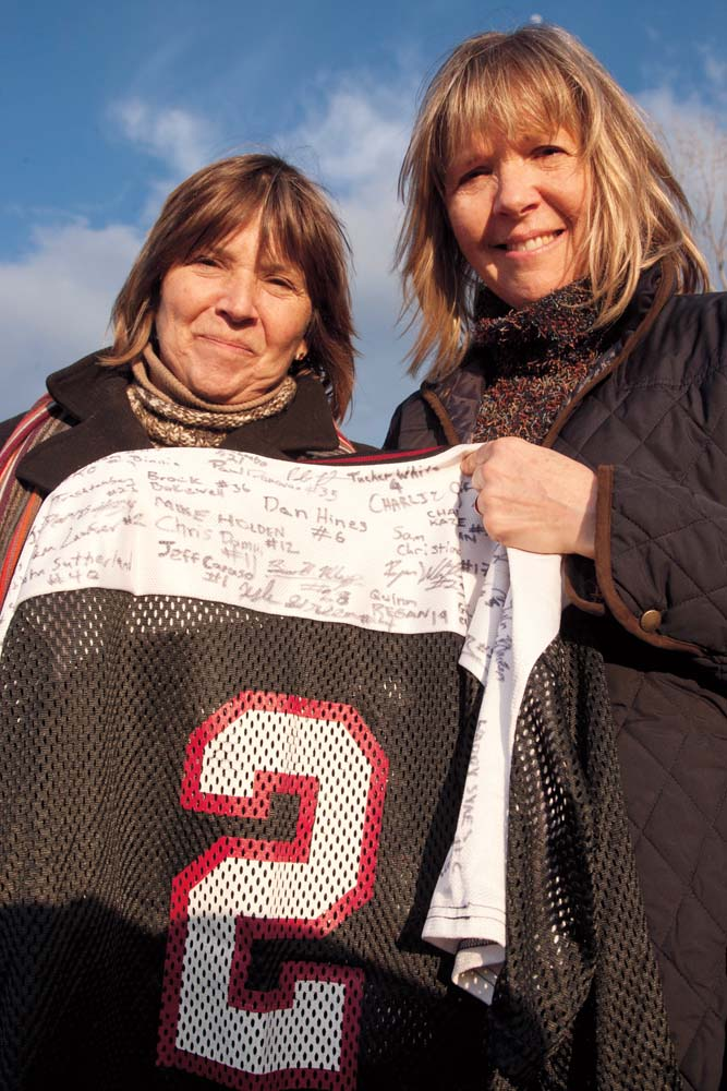 After the game McDuffee's mother, Lisa Freeman (left), and her sister, Laura Birdsall, pose with McDuffee's Bates lacrosse jersey, signed by both teams. Photograph by Phyllis Graber Jensen/Bates