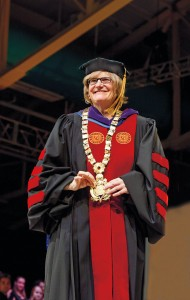 Clayton Spencer shows off the presidential collar following her installation as the college's eighth president.  Photograph by Mike Bradley