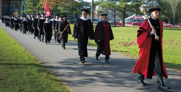 Mace bearer Sawyer Sylvester, professor of sociology, leads the academic procession to Merrill Gymnasium on Oct. 26, 2012. Photograph by Mike Bradley