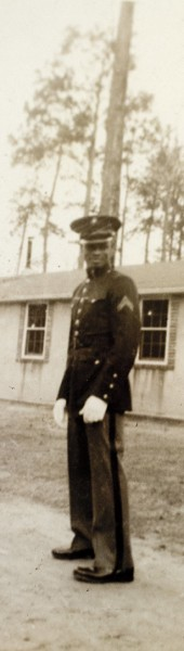 Wearing dress blues, Marine Cpl. Nate Boone poses for an unnamed buddy in front of a barracks at Montford Point, Camp Lejeune, N.C., in 1947.  Photograph courtesy the Boone family