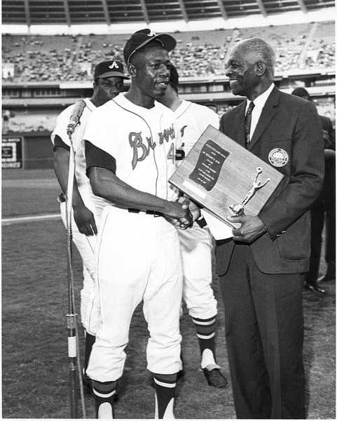 In this undated photo, Mays talks with baseball great Hank Aaron of the Atlanta Braves. Photograph courtesy of Howard University.