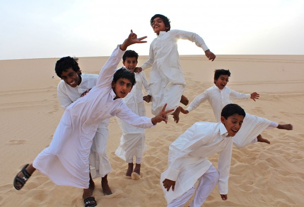 Saudi boys cavort in the desert. Photograph by Gintare Balseviciute '13
