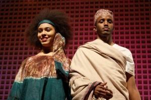 At Bates College's 2012 Inside Africa Fashion Show, sophomore Nerissa Brobbey models a Togolese boubou dress with matching head scarf. At right, Gulaid Abdullahi wears a traditional ma'awis and kofia hat. Photograph by Simone Schriger '14/Bates College.
