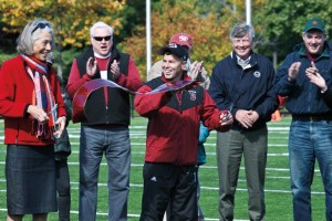 Hansen and Director of Athletics Kevin McHugh cut the ribbon at the dedication of renovated Garcelon Field in 2010. Photograph by Janet Cuimmei P'12.