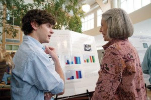 Hansen talks with Owen Harris '08 about his neuroscience research on therapies for Parkinson's disease.
