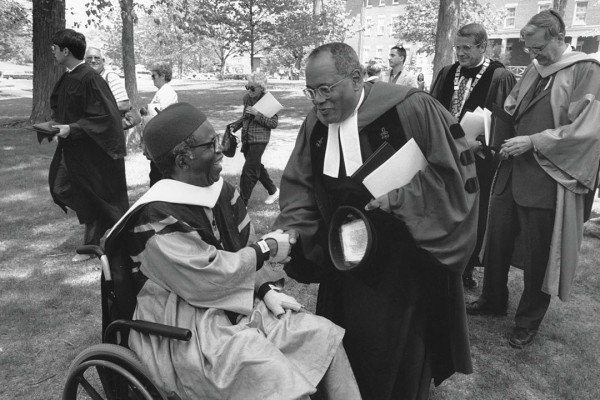 Gomes and Nigerian novelist Chinua Achebe greet one other after Commencement 1996, when both received Bates honorary degrees. Photograph by Marc Glass '88/Bates College.