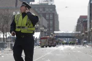 A Boston police officer shouts instructions on Boylston Street in Boston on April 15, 2013. Photograph by Bates photographer Mike Bradley, who was at the marathon earlier in the day and returned to cover the aftermath for a New York City media outlet.