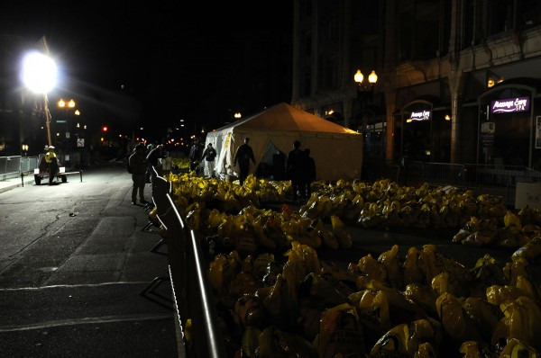 Bags that were left unclaimed by marathoners are collected on Berkeley Street in Boston on April 15, 2013. Three people were killed by two explosions on Boylston Street near the finish line of the Boston Marathon, in which 27,000 people competed.