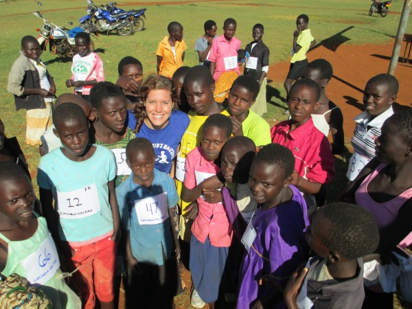 Devin Tatro '14 with some of the competitors in the first Kapchowra Kids Race, held Dec. 1, 2012 in Kapchowra, Uganda.
