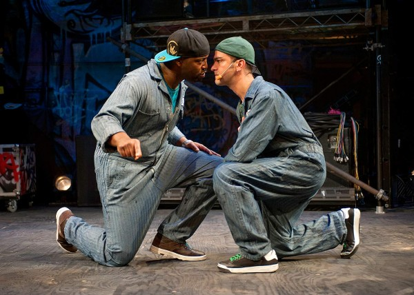 Postell Pringle '98 (left, as Othello) and GQ (Iago) face off as Iago's plot unfolds in Chicago Shakespeare Theater's production of Othello: The Remix. Photograph by Michael Brosilow.