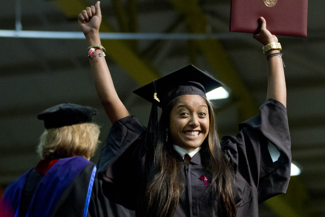 An exuberant Zaihra Ahmed '13 shows off a product of four years' hard work at Bates. Photograph by Phyllis Graber Jensen/Bates College.