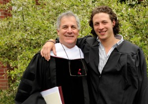 Commencement speaker and honorary degree recipient Gary Hirshberg and his graduate son, Ethan '13, pose for a photograph after the ceremony. Photograph by Jose Leiva.