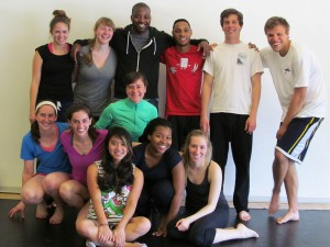 Postell Pringle '98, center rear, and his classmate Erin Gottwald (in green) led these students in creating a piece for the 2013 Tour, Teach, Perform unit.