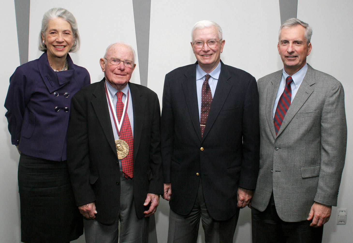 In 2008, Kinney, wearing his just-awarded Benjamin Mays Medal, poses with then-President Elaine Tuttle Hansen and his successors as chairs of the Board of Trustees: Jim Moody '53 (second from right) and Joe Willett '73.