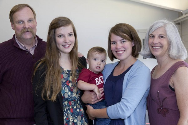From left, Donald Wason '79 with daughters Sarah '13 and Rebecca Wason St. Cyr '09 and wife Nancy '81. Rebecca holds her son -- future Bates Class of 2034?