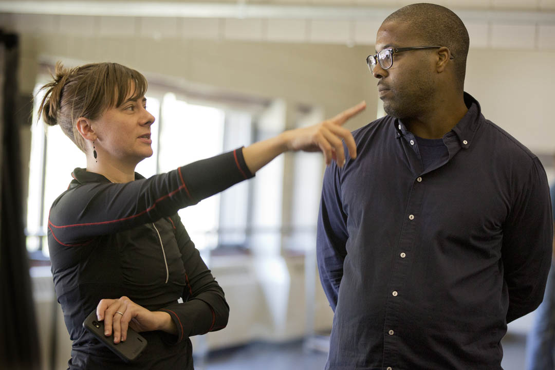 "Choreographer and dancer Erin Gottwald '98 confers with rapper, writer, actor and director Postell Pringle '98. The classmates are on campus to lead longstanding Short Term unit ""Tour Teach Perform,"" in which students create a dance piece and teach it to pupils in local schools. (Phyllis Graber Jensen/Bates College)"