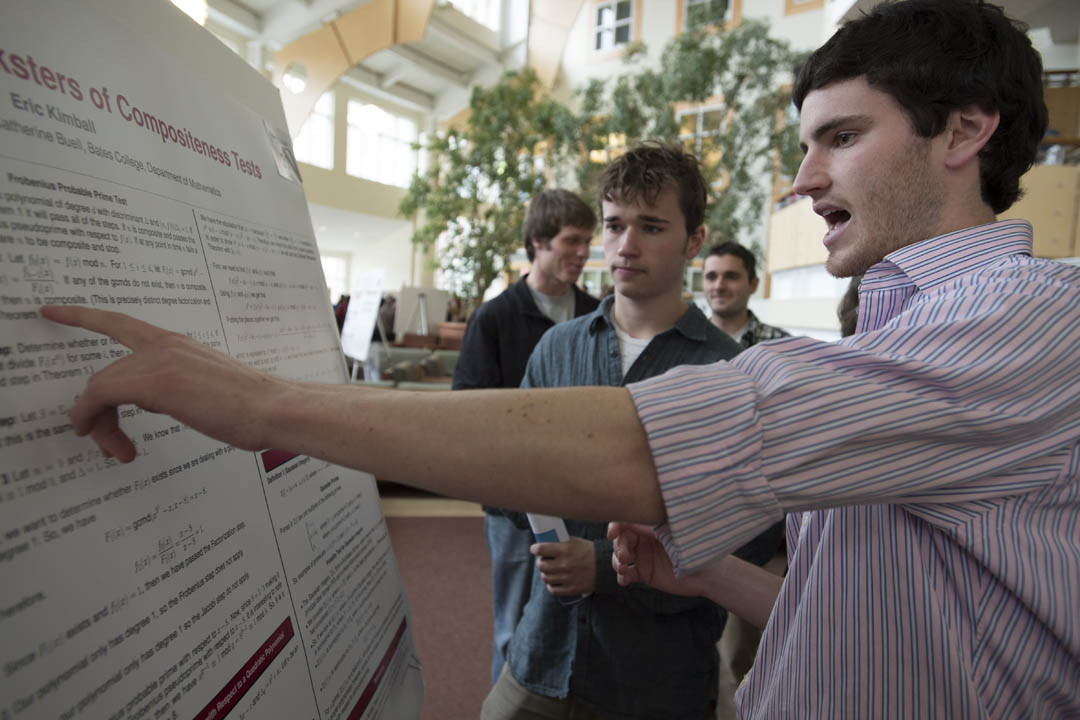 Eric Kimball '13 talks about his poster project during the Mount David Summit. (Mike Bradley/Bates College)