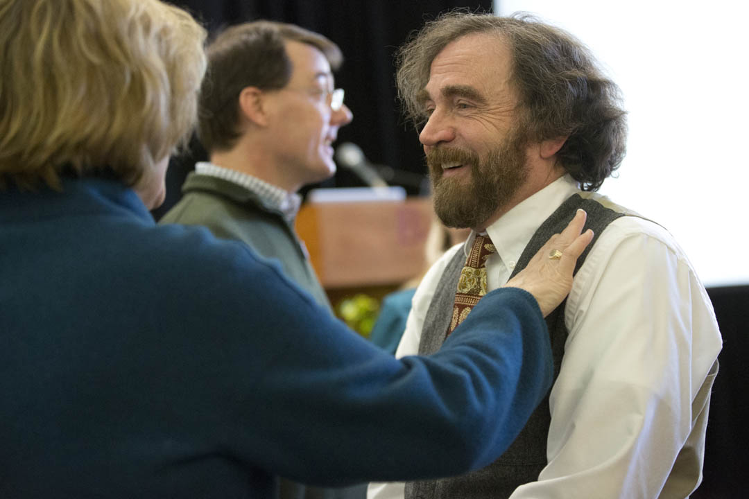After delivering the Charles A. Dana Professorship Lecture in Memorial Commons,  Dana Professor of Chemistry T. Glen Lawson receives congratulations from President Clayton Spencer. (Phyllis Graber Jensen/Bates College)