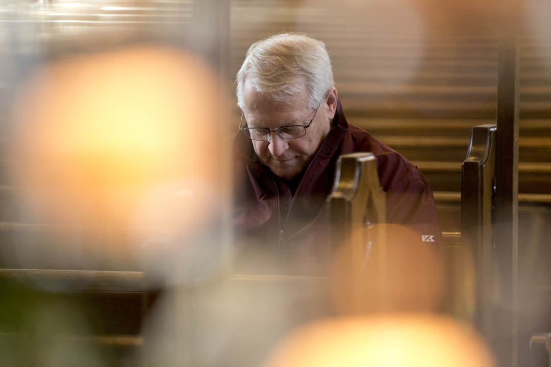 Director of Security and Campus Safety Tom Carey '73 pauses for a moment of reflection about the Boston Marathon bombing during a service organized by the Multifaith Chaplaincy in the Peter J. Gomes Chapel. (Phyllis Graber Jensen/Bates College)