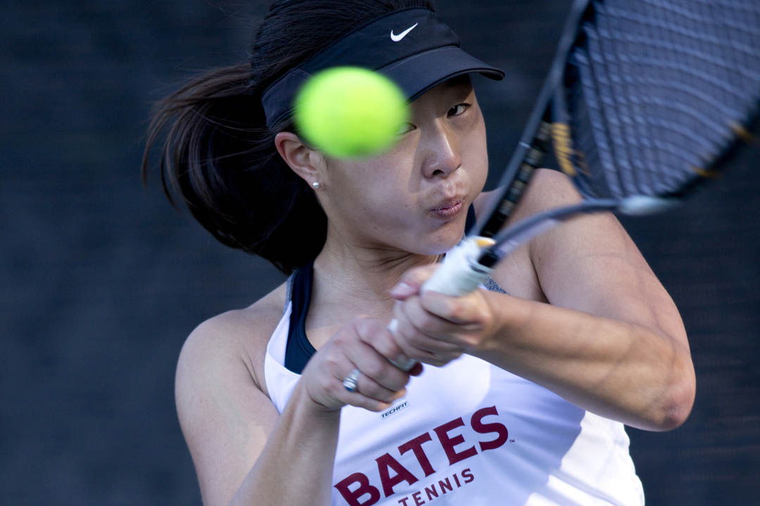Ashley Brunk '13 has her eye on the ball during a doubles match with partner Elena Mandzhukova '15. The Bates team lost to Bowdoin, 2-8. (Phyllis Graber Jensen/Bates College)