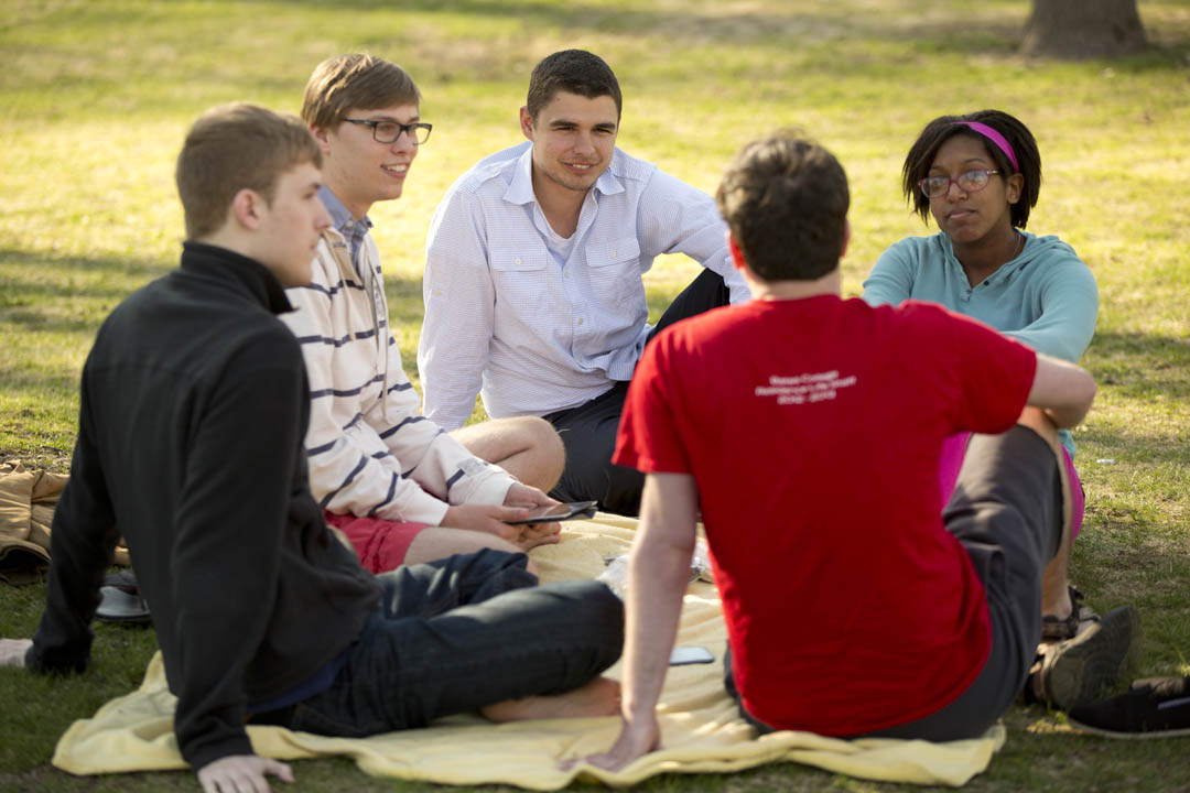 Students gather on the Historic Quad -- and a blanket -- for a study session. (Phyllis Graber Jensen/Bates College)