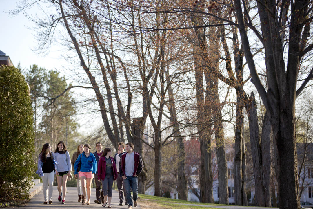 A group of friends crosses the Historic Quad in high spirits. (Phyllis Graber Jensen/Bates College)