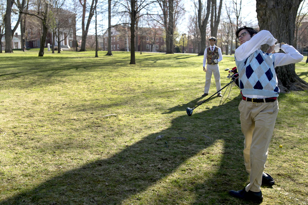 Jon Pelz '16 (right) and his twin brother Chris Pelz '16 practice golfing with foam golf balls on the Historic Quad. (Mike Bradley/Bates College)