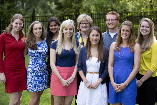 With the exception of Hakimah Abdul-Fattah and Cameron Sheldon, who were abroad, the 2013 Fulbright grant recipients attended a May 13 reception at the home of Bates President Clayton Spencer. From left: Catherine Tuttle, Libby Egan, Tara Prasad, Marisa Mohrer, Spencer, Valerie Jarvis, Hansen Johnson, Nora Hanagan, Taryn O'Connell. Photograph by Phyllis Graber Jensen/Bates College.