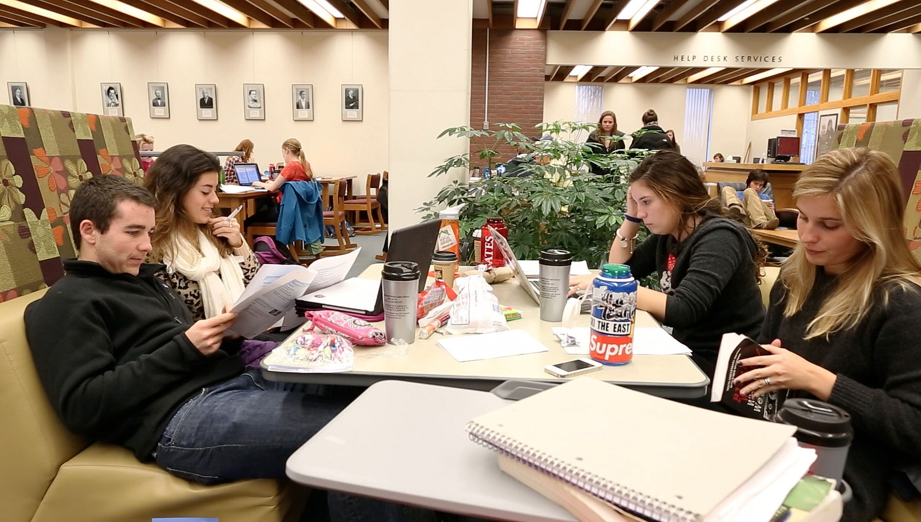 Students are variously engrossed in their work during finals week, fall semester 2012, in Ladd Library. Photograph by Phyllis Graber Jensen/Bates College.