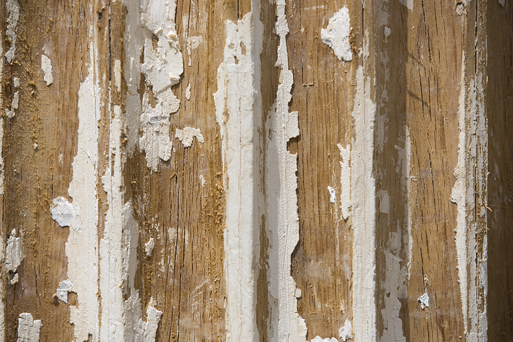 "Beneath 60 layers of paint lies the ""original substrate"" of Hathorn's columns: Southern yellow pine. Mike Bradley/Bates College."