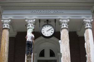 Giles Giguere of Higgins Custom Painting in Lewiston works on removing 60 layers of paint from the columns of Hathorn Hall. Mike Bradley/Bates College.