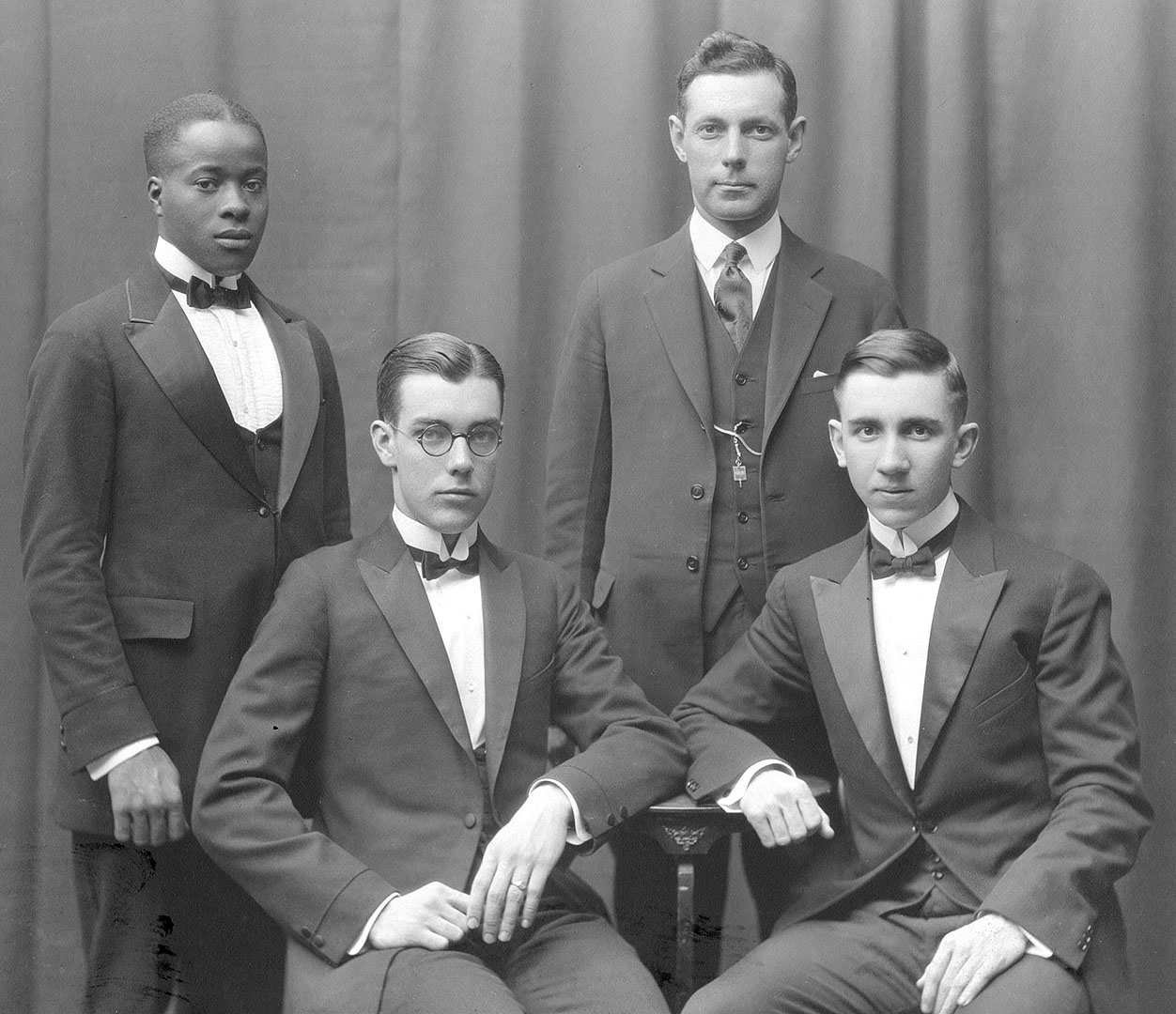 Debaters of 1923, the era of the first alumni fund. From left, Theodore Pinckney '23, later an orthopedic surgeon; Erwin Canham '25, Rhodes Scholar and editor of the Christian Science Monitor, Professor Craig Baird, and William Young '24, later head of elementary education in New York state. Photograph courtesy of Muskie Archives and Special Collections Library.
