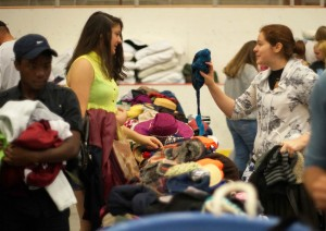 Girls picking out accessories. Photograph by Vasu Leeaphon/Bates College