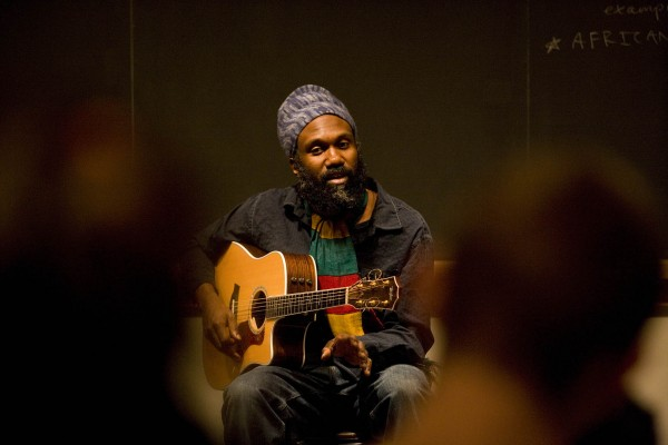 Corey Harris performs in 2008 at Bates College, where he is a member of the class of 1991. Photograph by Phyllis Graber Jensen/Bates College.