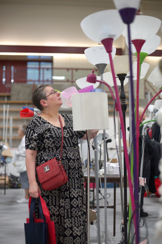 A Clean Sweep customer examines a display of lamps. Photograph by Vasu Leeaphon '15/Bates College.