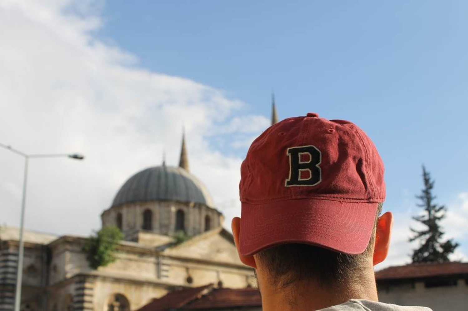 B=Bobcat. Jivko Kozarov '14 looks at a mosque in Gaziantep in southeast Turkey. Mosques appear in many urban settings, and in some parts of Turkey they stand out in the skyline. Phillip Dube '16/Bates College.