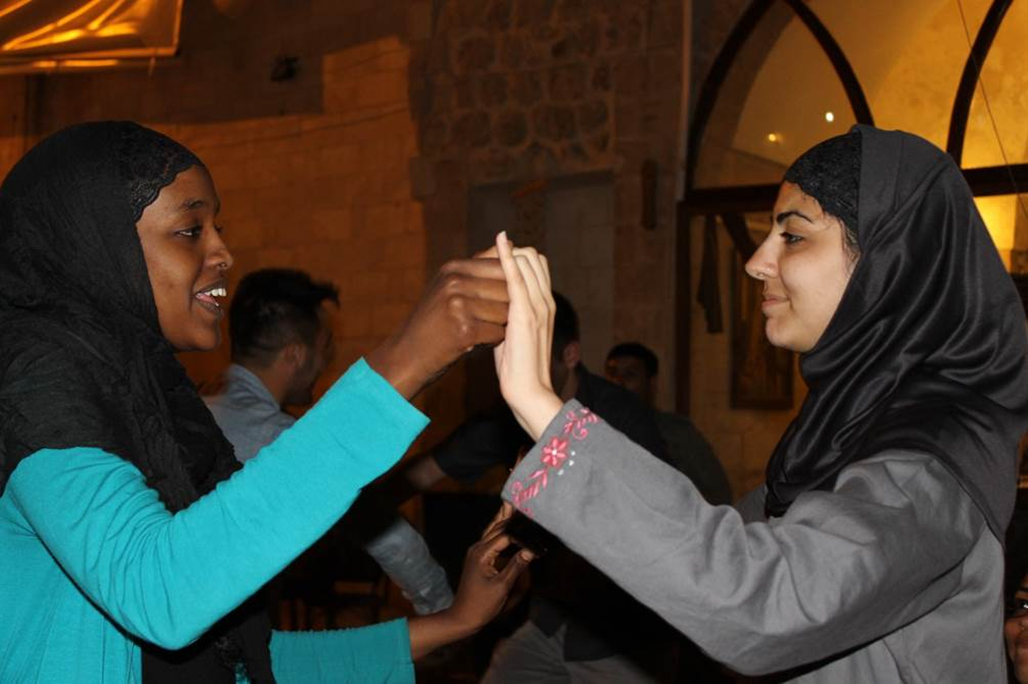 (From left) Asha  Mohamud '15 and Amna Ilyas '13 dance to show their love for Turkish folk music and celebrate their friendship, at a restaurant in Gaziantiep , southeast Turkey. Phillip Dube '16/Bates College.