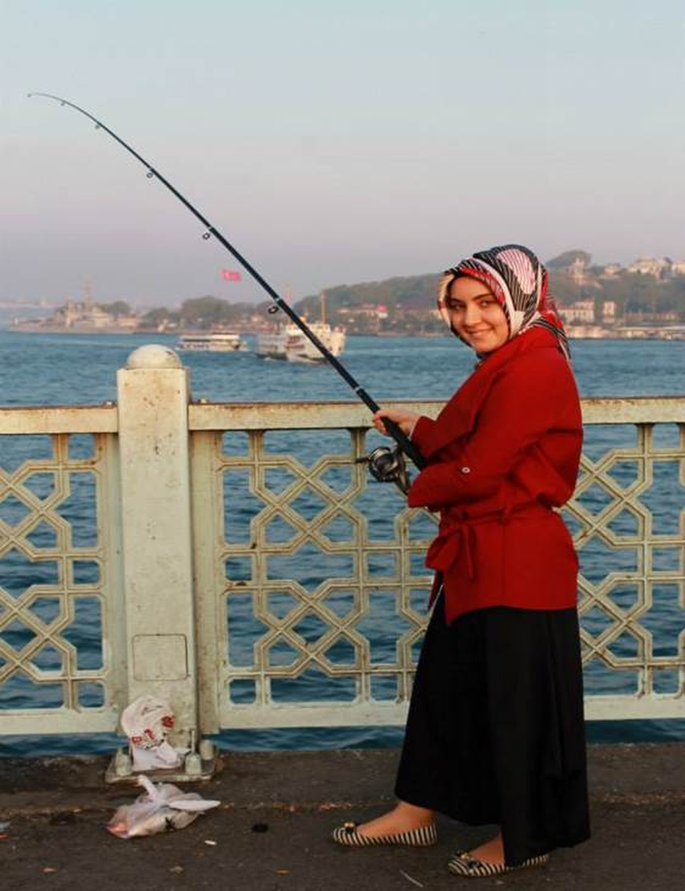 A woman fishes from the bridge across the Bosphorous in Istanbul. Women fishing on this bridge are a rare sight. I was surprised to walk across the bridge at night and see people fish and some make dinner on the sidewalk. Photograph by Kelsey Schober '16.