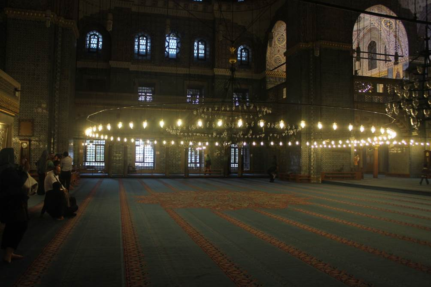 Interior of the spacious Old Mosque in Istanbul. Most of the mosques are well-carpeted and brightly lit. Wearing shoes in a mosque is prohibited, but the carpets kept our feet warm and comfortable. Phillip Dube '16/Bates College.