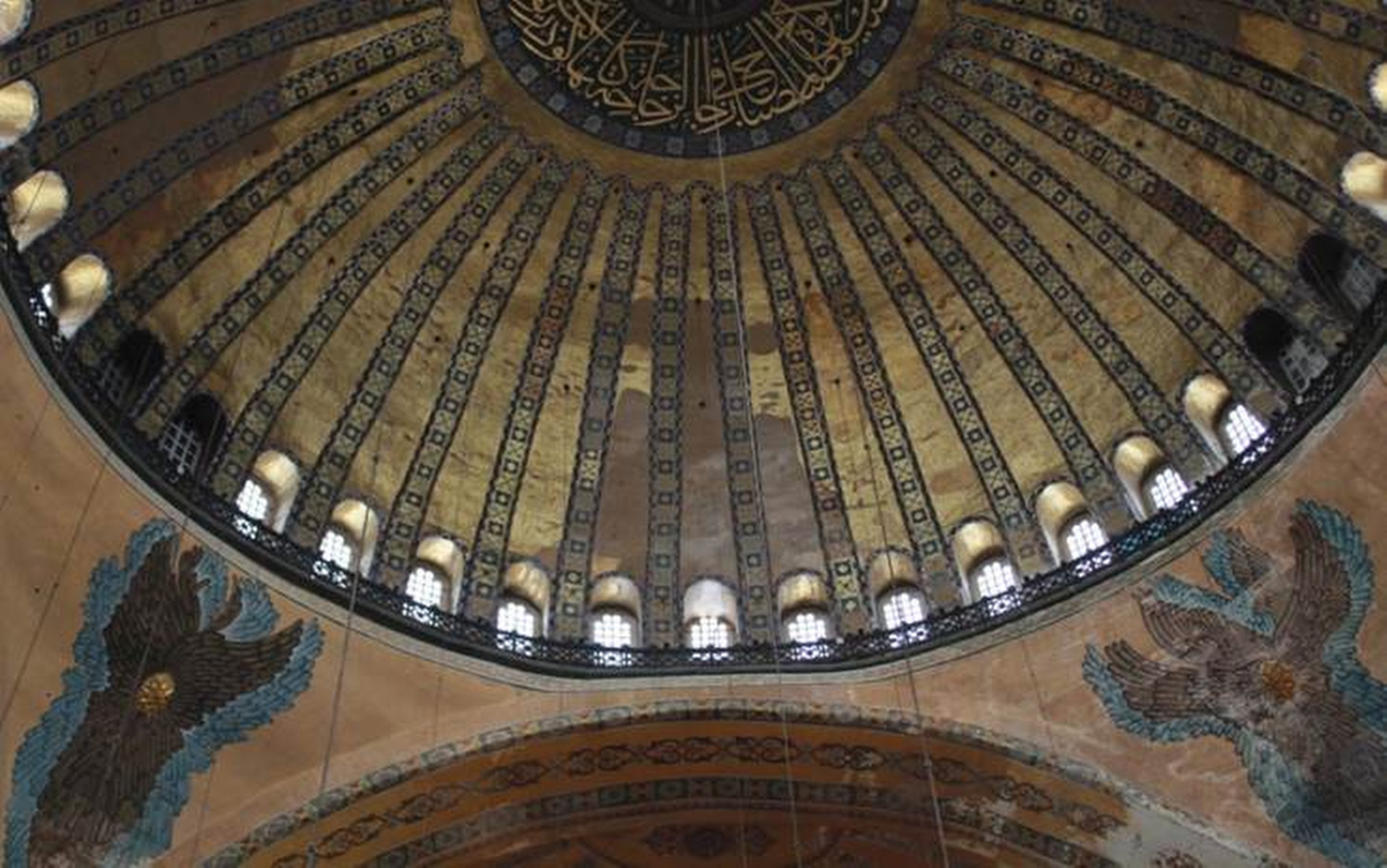 The interior of Istanbul's Hagia Sophia Museum, which is being refurbished. It was initially a church but later converted to a mosque. I found it amusing that frescoes (lower corners) and Islamic calligraphy (center top) coexist in the same space, yet in the world outside of a museum, the two rarely appear in the same context. Phillip Dube '16/Bates College.