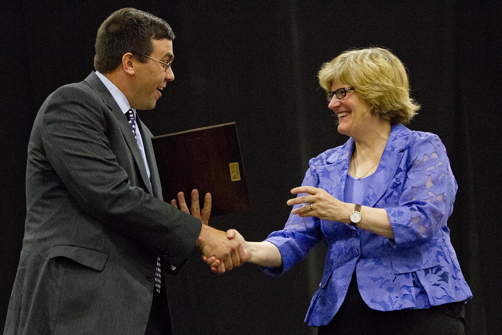 Brad Adams '92 is congratulated by President Clayton Spencer as he receives the Stangle Award for Distinguished Service to the Bates Community on June 8, 2013, at Reunion. Photograph by Phyllis Graber Jensen/Bates College.
