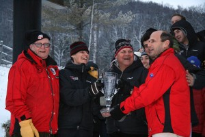 Becky Flynn Woods '89 and her father Bob Flynn (second from right) accept the Chummy Broomhall Cup as the top Maine college ski team from then-Maine Gov. John Baldacci in 2007. The award's namesake, Chummy Broomhall, is at left. Photo courtesy of Kris Dobie.