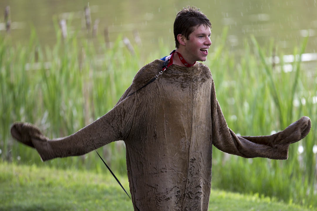 Conor Maginn '13 tries to dry off after emerging from the puddle at the conclusion of a senior week activity on May 20, 2013. (Mike Bradley/Bates College)