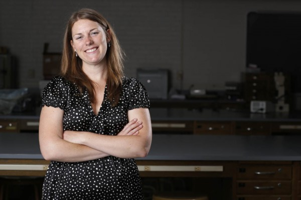 "In a sense, Bates biologist Larissa Williams studies the process of evolution as it happens. ""I look at the differences between the genomes of animals that live in clean places and in polluted places to find suggestions of how they survive in the polluted environments,"" she says. (Mike Bradley/Bates College)"