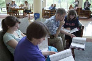 A family studies materials distributed during an on-campus admission program. (Phyllis Graber Jensen/Bates College)