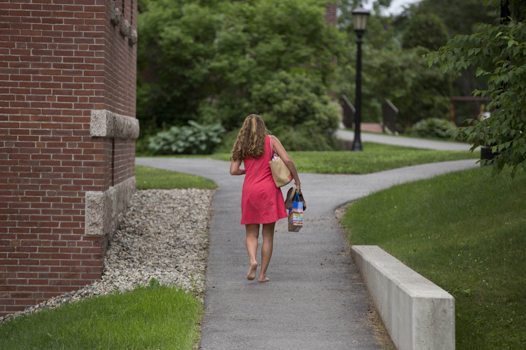 After participating in a college admission experts panel, Ilse Abusamra '97 takes a nostalgic walk across the historic Quad. (Phyllis Graber Jensen/Bates College)