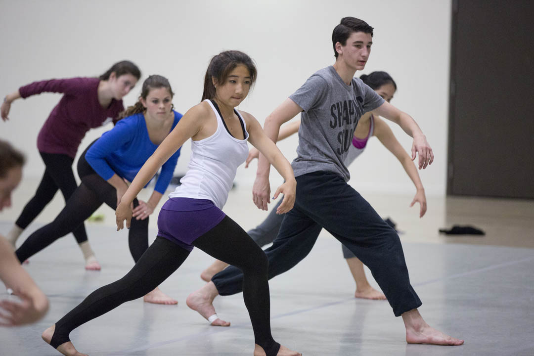 "On the second day of the Bates Dance Festival's Young Dancers Workshop, students in Heidi Henderson's modern dance class begin a three week-process of  ""reveling in the specificity of complex movement sequencing, dancing large loopy phrases, and feeling joy."" (Phyllis Graber Jensen/Bates College)"