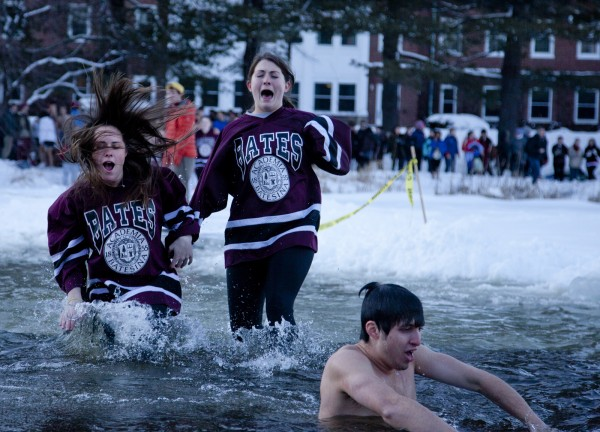 Puddle Jump participants take the plunge into frozen Lake Andrews during Winter Carnival. Run by the college's historic student Outing Club, the premise is simple: Cut a hole in the ice of Lake Andrews and invite anyone to jump in. Photograph by Phyllis Graber Jensen/Bates College.