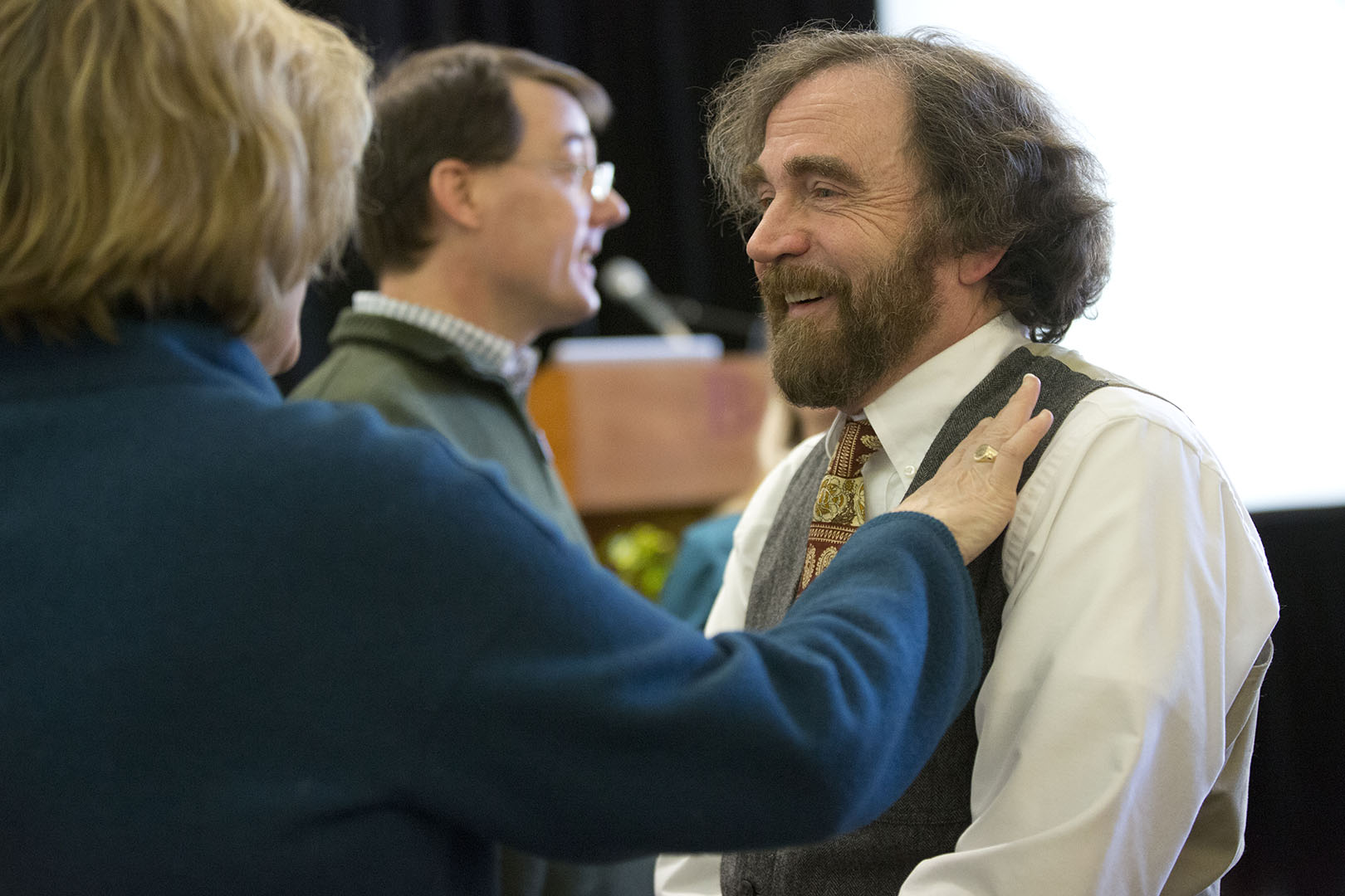Glen Lawson receives congratulations from President Spencer at the celebration of his appointment as the Charles A. Dana Professor of Chemistry. Six professors were appointed to named professorships in 2013. Phyllis Graber Jensen/Bates College.